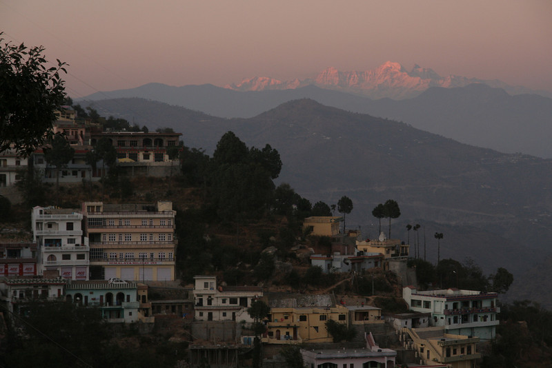 The Hill station of Chamba, India, flanked by the Himalayas at dusk.  I took this after I was stranded for a day due to my motorcycle engine seizing on me.  If I had to be stranded, at least it was in a beautiful, albeit cold, place.