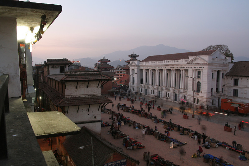 Downtown Katmandu, Nepal, at dusk.  This is the only time of day the smog eases enough that one can see the incredible peaks surrounding the Katmandu valley.