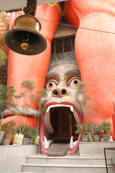 This is a 6 story tall Shiva temple in the shape of Shiva.  The bell is what you ring as you enter any temple here and the monkey (whos mouth you walk through to enter the temple) signifies something evil but that I have forgotten what it is exactly.  i'll have to ask Gopi, she knows.
