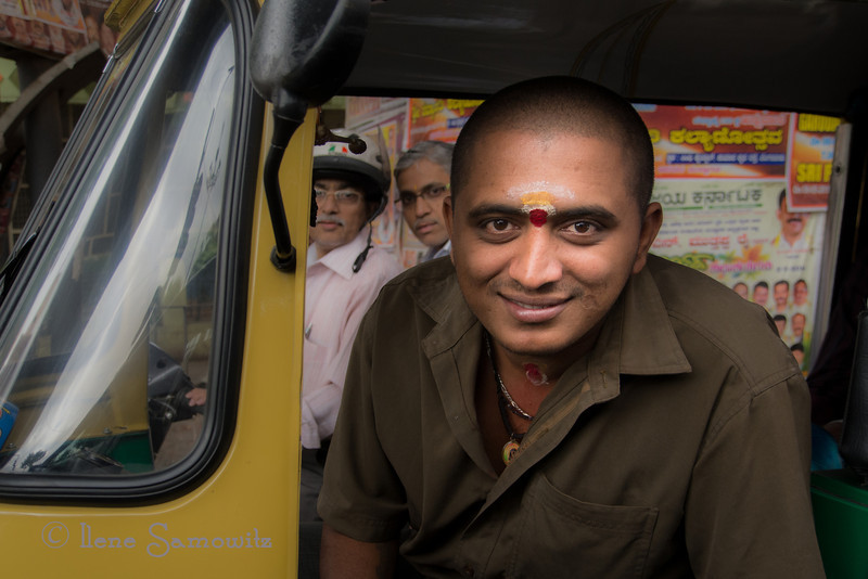 Rickshaw Driver in Bangalore. This is the first of the photos I took from India. This was taken on my last day. We were stopped at the light in our car and I was shooting the area.  The rickshaw driver asked me to take his photo and I happily obliged.