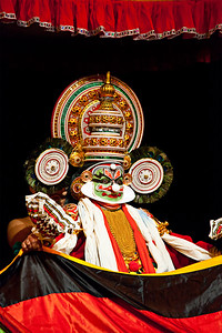 Kathakali dance. Bhava Bhavanam Festival. September 2009. Chennai, India. Kathakali is a famous dance-drama of south indian state of Kerala.  Ravana (kathi) character.  In the beginning of play actor is hidden behind the therasila, little by little showing up.