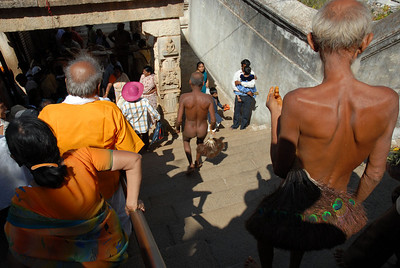 Naked Jain priests keeping it real. The peacock feather brooms in hand are symbolic of their reverence for all living things, sweeping even the vulnerable little insects out of their path. In reality they use it to brush humans aside so they can get ahead of you.