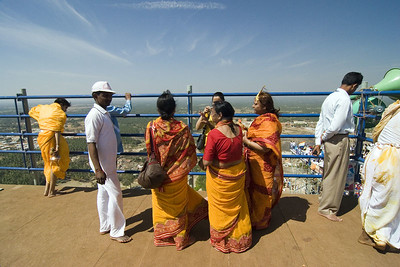 Devotees chatting at the top of the tower. There is actually an elevator there for people unable to climb the stairs.