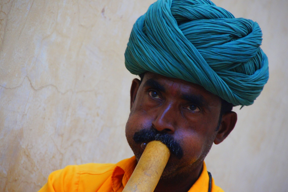 A snake charmer performs a mesmerizing song just outside of the Fort.