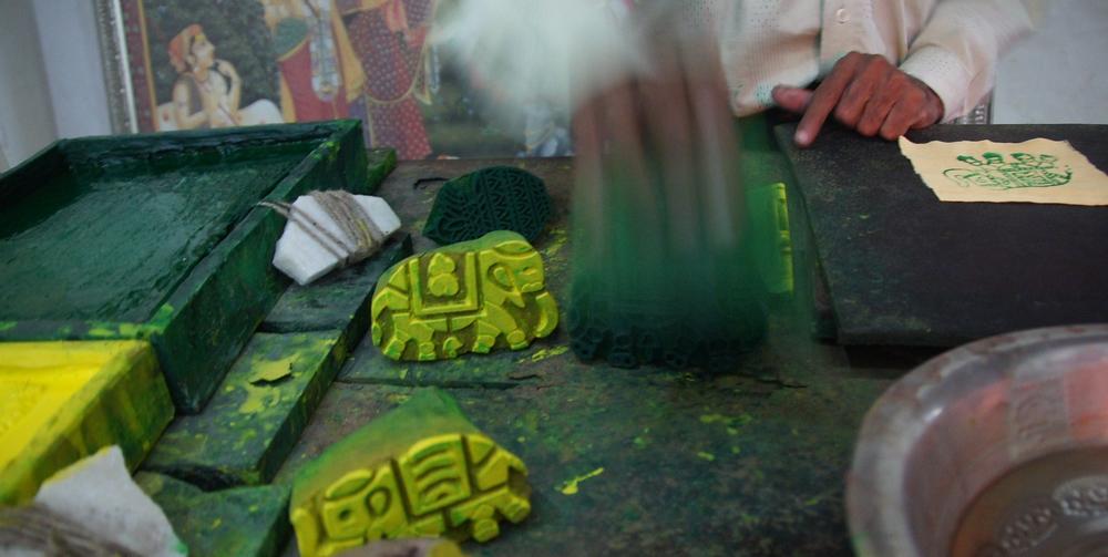 An Indian man demonstrates how he makes elephant dye imprints - Jaipur, India.