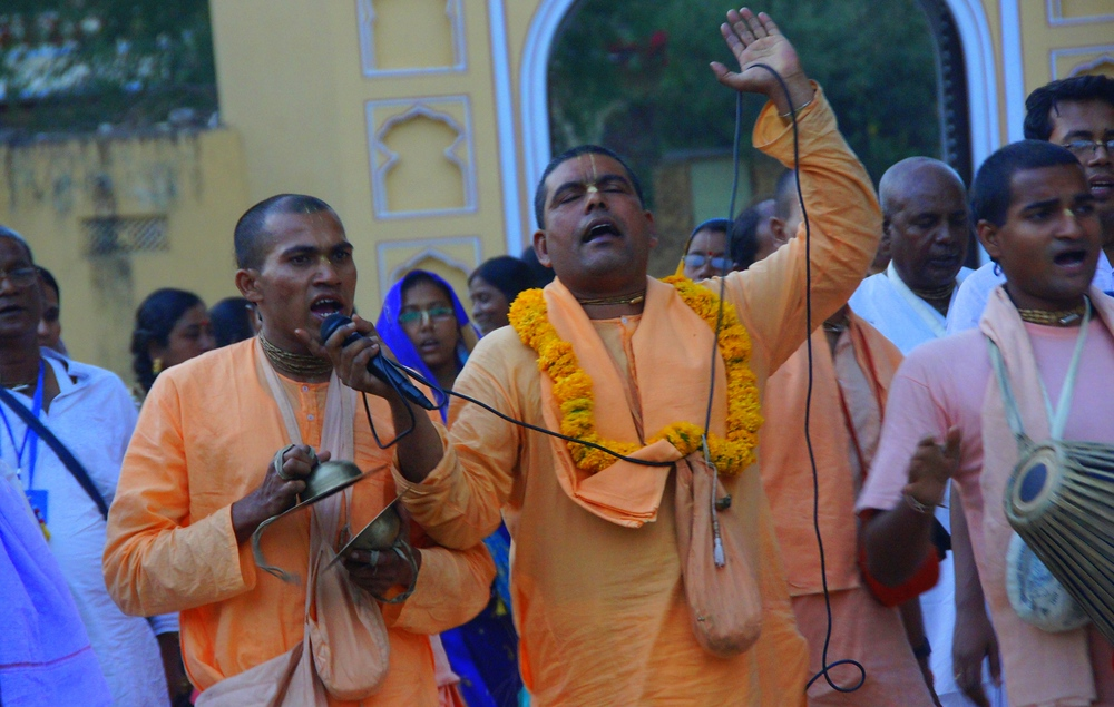 Some Indian men perform an animated song to the delight of those watching.