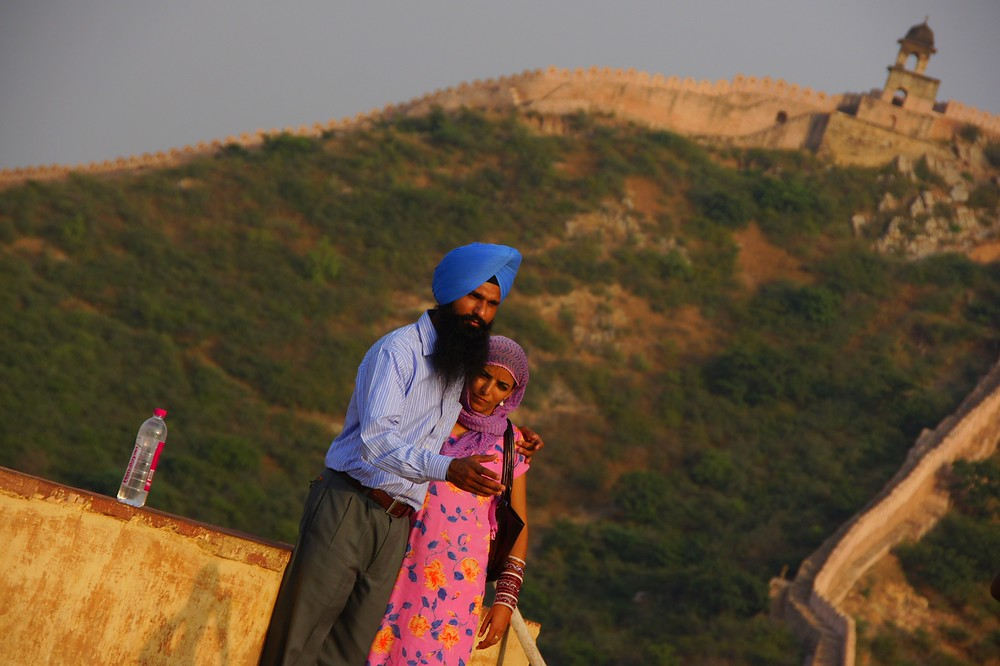 A couple pose at this Fort with a wonderfully scenic backdrop in the distance.