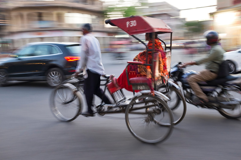 Rickshaw in Delhi rush hour traffic.