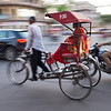 Rickshaw in Delhi rush hour traffic.