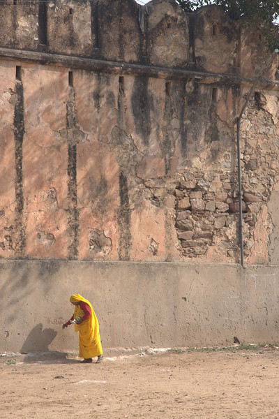 Lady, by the Pink City wall.Jaipur