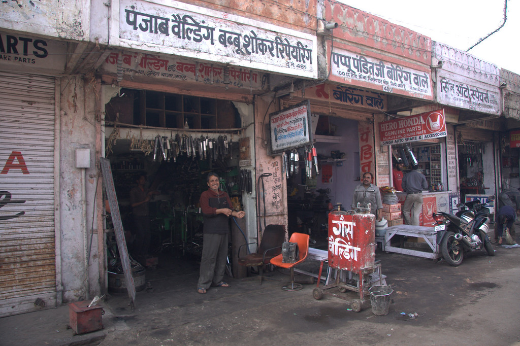 motorbike repair, shops along the walls of  the Pink CityJaipur