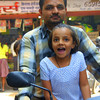 "Exuberant times with Dad on the motorcycle - as this little girl smiles wide open - Jodhpur, India.  Travel photo from Jodhpur, India. <a href=""http://nomadicsamuel.com"">http://nomadicsamuel.com</a>"