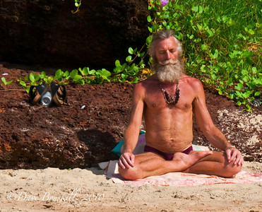 Practicing Yoga on the beach in Varkala, Kerala