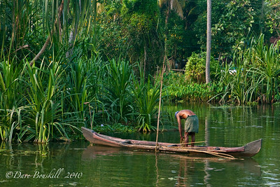 Boat man on the backwater river in Alleppey, Kerala, India