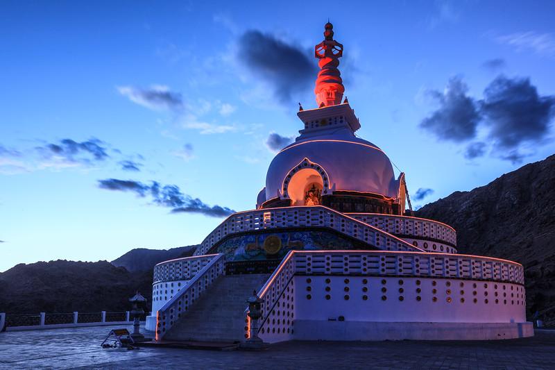 Shanti stupa illuminated in the evening twilight. Leh, Ladakh