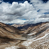 View over valley and Karakorum range from Kardung La pass, Ladakh, India