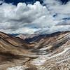 View over valley and Karakorum range from Kardung La pass, Ladakh, India