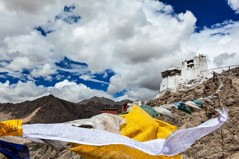 Leh gompa and lungta (prayer flags). Leh, Ladakh, India