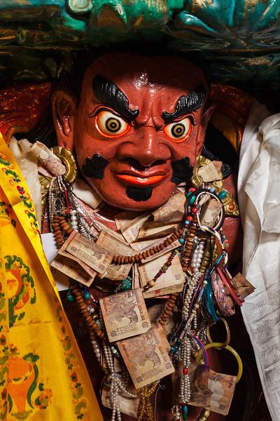 Statue of wrathful protective Buddhist deity in Hemis gompa. Ladakh, India