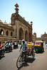 A rickshaw drives pass the main bates of Bara Imambara