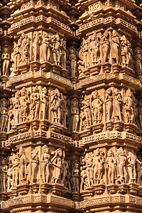 Famous stone carving sculptures, Kandariya Mahadev Temple, Khajuraho, India. Unesco World Heritage Site, Hindu, Hinduism, India, Kandariya Mahadev, Kandariya Mahadev temple, Kandariya Mahadeva temple, Khajuraho, Madhya Pradesh, activities, ancient, architectural, architecture, building material, carve, carved, carving, construction material, exterior, historic, historical, history, image, indian, ornate, outdoor, outdoors, outside, place of worship, religion, religious, religious building, sandstone, sculpture, statuary, statue, stone, stone sculpture, temple, temples, tourism, travel