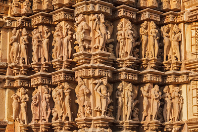Stone carving bas relief sculptures on Vaman Temple, Khajuraho, Madhya Pradesh, India
