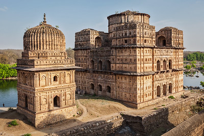 Royal cenotaphs of Orchha. Orchha, Madhya Pradesh, India, Betwa river, Bundelkhand, India, Madhya Pradesh, Orchha, architectural, architecture, cenotaph, exterior, indian, mausoleum, outside, river, royal, ruins, sundown, sunset, tomb