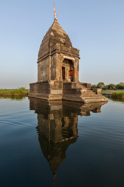 Baneswar temple (Small Hindu temple dedicated to Shiva) in the middle of the holy Narmada River, Maheshwar, Madhya Pradesh state, India