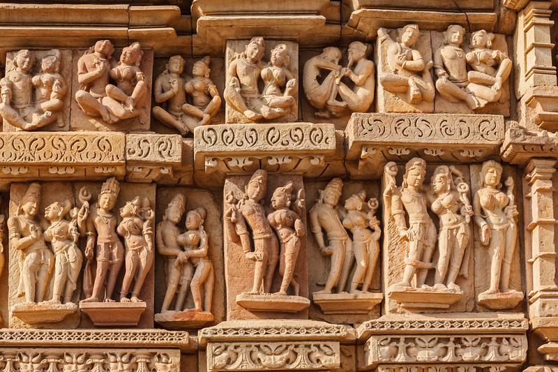 Stone carving bas relief sculptures on Adinath Jain Temple, Khajuraho, Madhya Pradesh, India