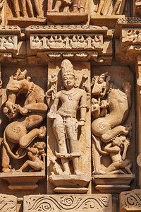 Stone carving bas relief sculptures on Adinath Temple, Khajuraho, Madhya Pradesh, India