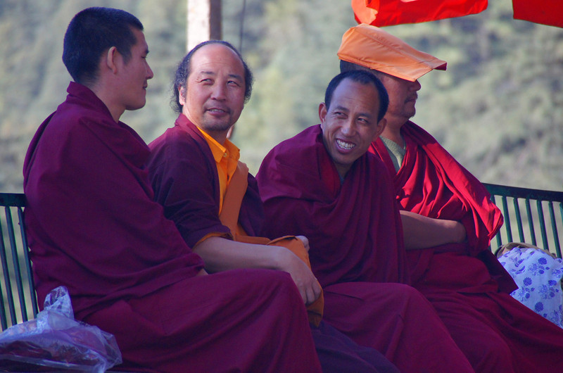 """Tibetan monks enjoy a laugh over a candid conversation in Mcleod Ganj, India.  This is a travel photo from Mcleod Ganj, India. <a href=""""http://nomadicsamuel.com"""">http://nomadicsamuel.com</a>"""