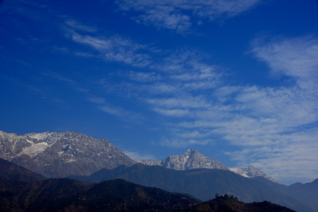 The serene snow capped mountains, blue skies and high altitude of Mcleod Ganj (Dharamsala), India.  Travel photo from Mcleod Ganj (Dharamsala), India.
