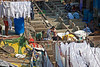 Men working at Dhobi Ghat in the open air laundromat in Mumbai, India.