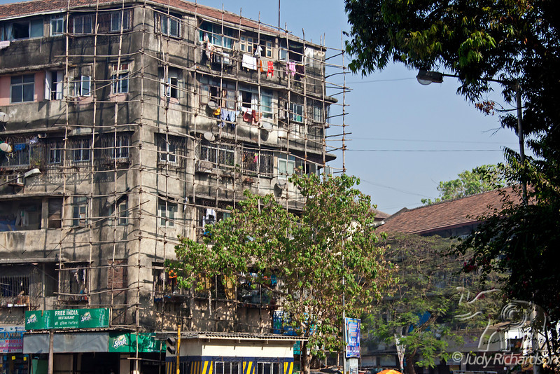 Building in Mumbai with clothes hanging out to dry.