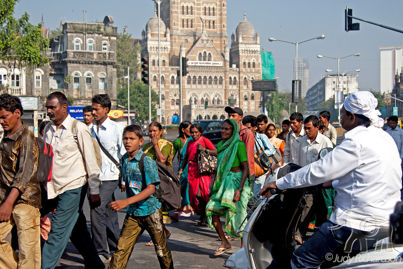 People on sidewalk on Sunday in Mumbai.