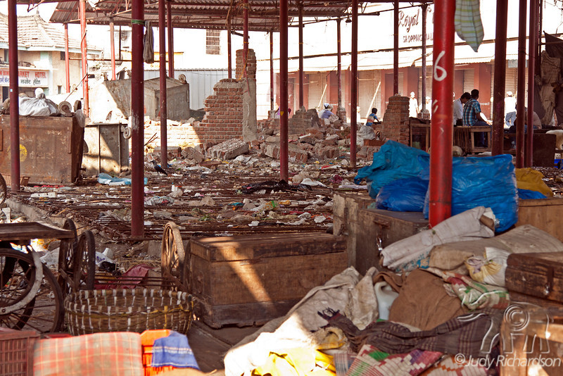 Crawford Market on a Sunday...loaded with trash and sleeping people.