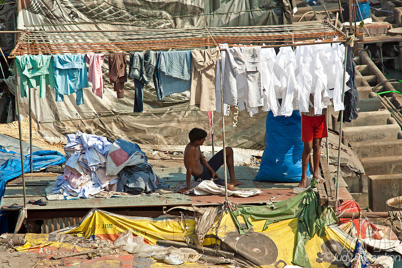 Dhobi Ghat, an open air laundromat, in Mumbai, India is a huge complex area where many people are washing clothes.