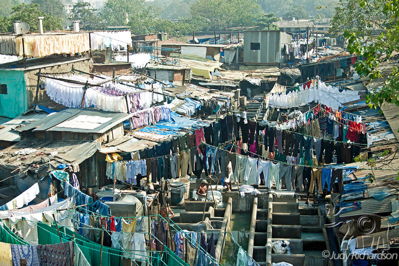 Dhobi Ghat is a well known open air laundromat in Mumbai, India. The washers work in the open to wash the clothes from Mumbai's hotels and hospitals.