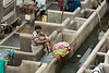 Man working at the laundry tubs, Dhobi ghat, Mumbai, India