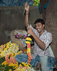 Man stringing marigolds for the Ganesha Festival, Mumbai, India