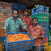 Men with basket of marigolds for the Ganesha festival, flower market, Mumbai, India