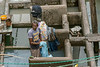 "Portrait of a man washing clothes in the laundry tubs, Dhobi ghat, Mumbai, India<br /> <br /> Loved his T-shirt! (best larger)<br /> <br /> Looking at these photos today, in the comfort of my house, gives me a greater appreciation for my washer and dryer and the other modern conveniences I have!  <br /> <br /> Other photos of the Dhobi ghat (plus one of some happy school girls) can be seen here:<br /> <br /> 9/05/14  <a href=""http://www.allenfotowild.com"">http://www.allenfotowild.com</a>"