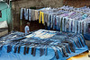 "Laundry blues<br /> <br /> The Dhobi Ghat has been called the world's largest unmechanized outdoor laundry.  It consists of rows and rows of open-air concrete wash pens, each fitted with its own flogging stone. The washers are called Dhobis and they wash most of the laundry from Mumbai's major hotels and hospitals.  <br /> <br /> More than 730 dhobis and their families live and work in the Dhobi Ghat, washing an average of 1 million articles of clothing per day. Work in a Dhobi Ghat is generally considered a hereditary occupation, passed down from generation to generation. The area extends across several city blocks and comprises an interlocking series of winding alleys and workrooms. The laundry workers reside in shanties that are permeated with the smell of chemicals from the nearby wash basins. Drying garments hang from clotheslines strung across every inch of space.<br /> <br /> Other photos from this colourful place can be seen here: <a href=""http://goo.gl/kTgM6Z"">http://goo.gl/kTgM6Z</a><br /> <br /> 7/05/14  <a href=""http://www.allenfotowild.com"">http://www.allenfotowild.com</a>"