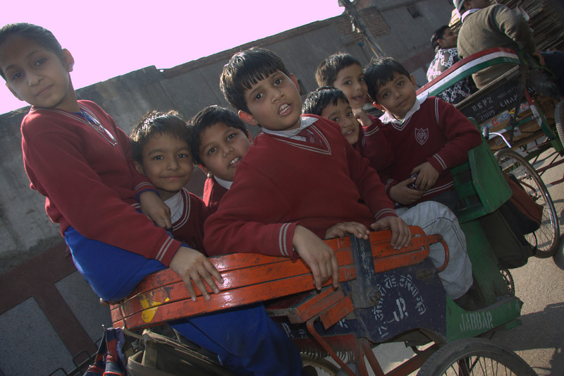 how many school kids can you get on a bicycle rickshaw.. poor man!