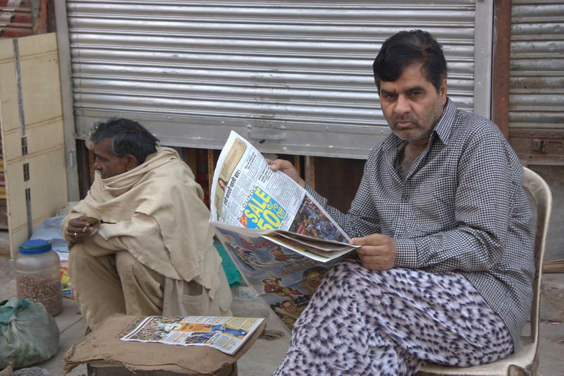 morning read,  in the Paharganj area, New Delhi