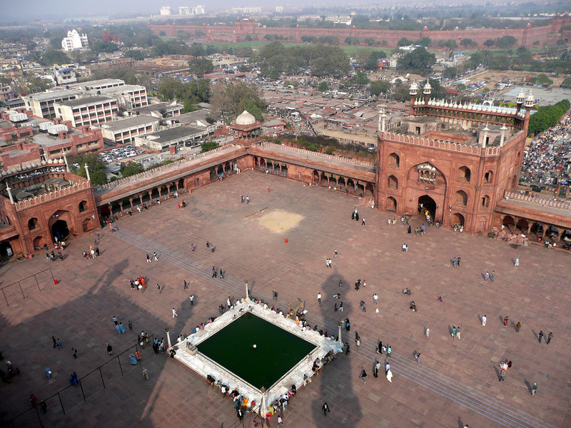 View from a minaret  at Jama Masjid Mosque in Chandi Chowk, Delhi. The Red Fort is in the distance.