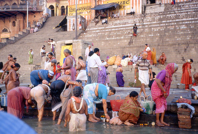 Varanasi pilgrims and bathers, right next to the burning ghat