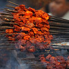 """Smoking satay being offered up to large crowds forming outside the Jama Masjid - Old Delhi, India.  This is a travel photo from Old Delhi, India. <a href=""""http://nomadicsamuel.com"""">http://nomadicsamuel.com</a>"""