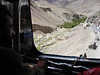 Hitching a ride with a truck on Leh-Kargil highway. Indus river down below. When the river floods, it also floods the Leh-Kargil highway.