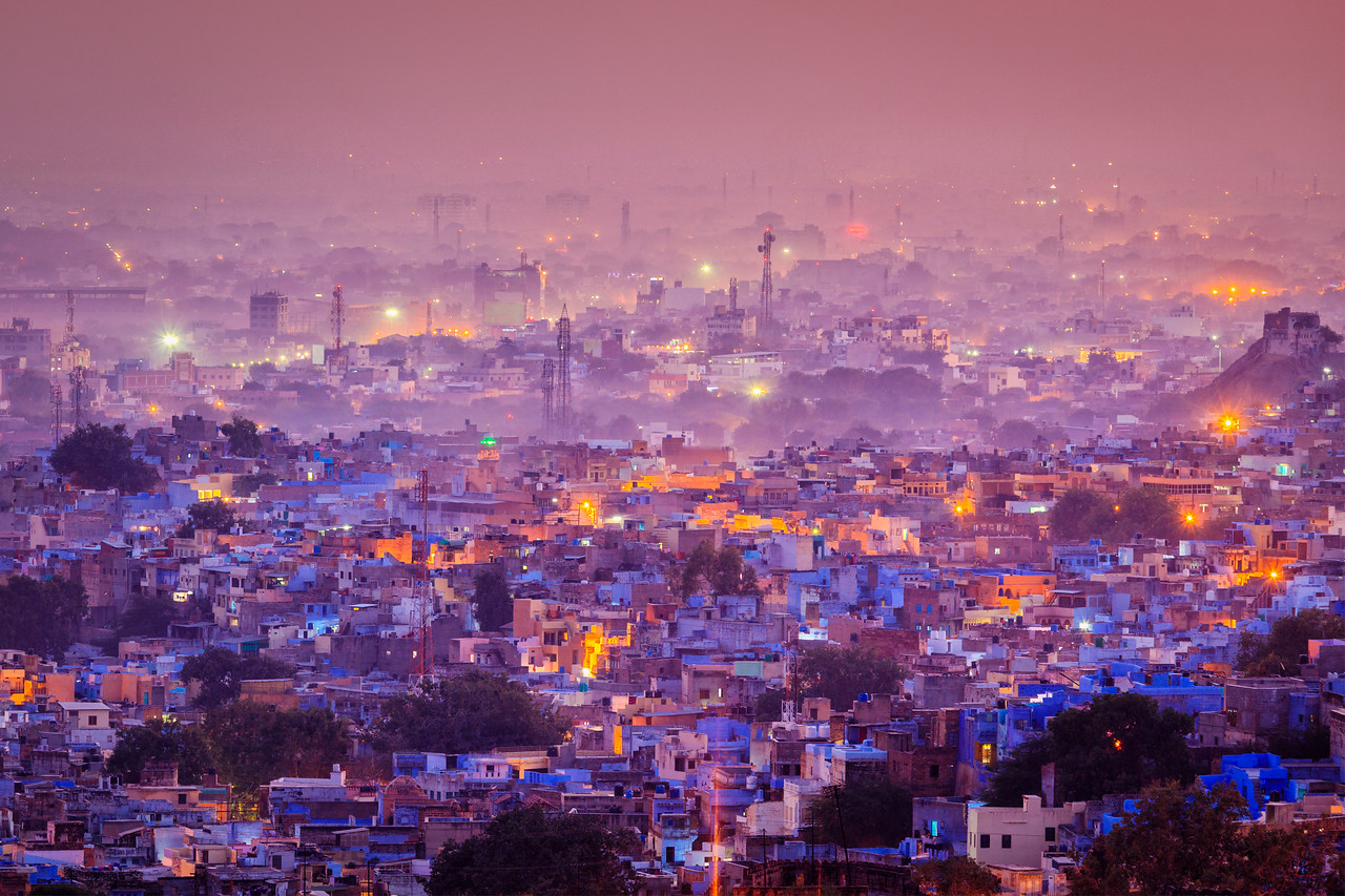 "Aerial view of Jodhpur, also known as ""Blue City"" due to the vivid blue-painted Brahmin houses around Mehrangarh Fort in the evening. Jodphur, Rajasthan"
